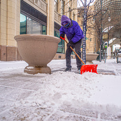 Snow removal in downtown Denver