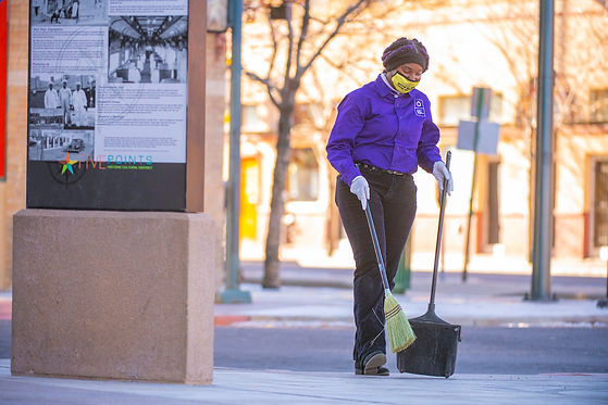 Pan and broom cleaning in the Denver Five Points Business Improvement District.