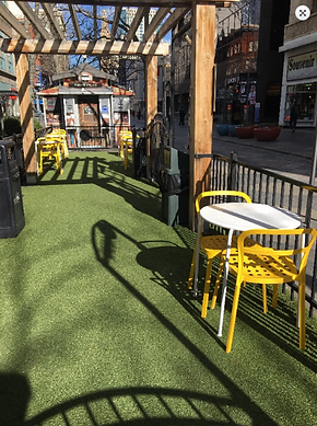 Clean public use area with tables and chairs