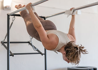 Woman exhibiting core strength on the Pilates Cadillac