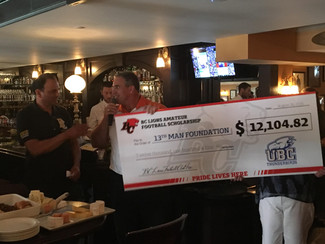 BC Lions presents check to the 13th Man Foundation