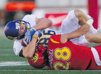 Dinos lower the boom on T-Birds. With sluggish offence, penalty-prone team couldn't match Calgary's