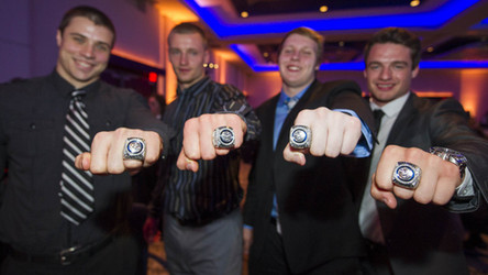 UBC Thunderbirds football players pick up their Vanier Cup rings