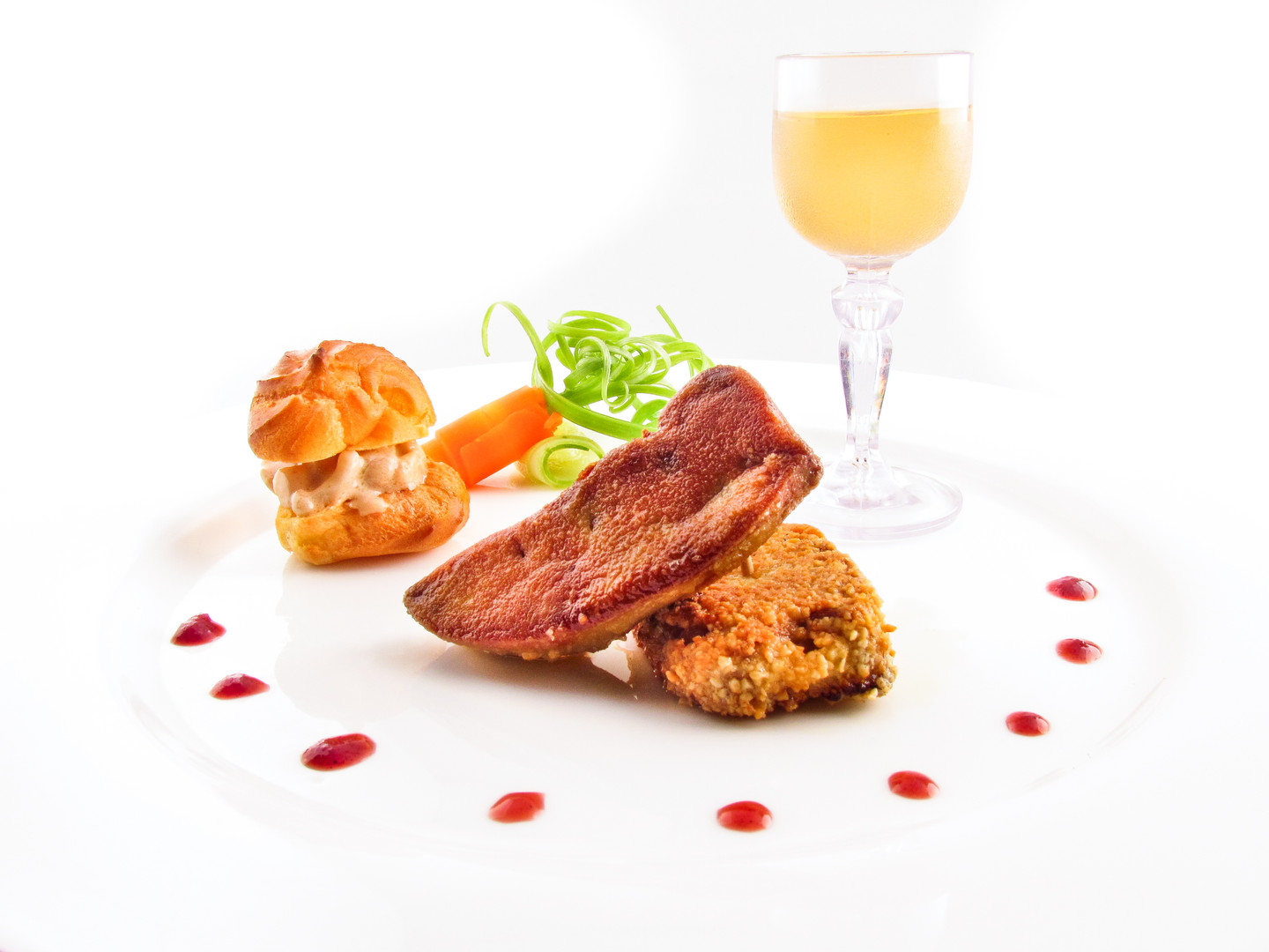 Breaded slices of duck foie gras with almond powder, Wine syrup with 4 spices.jpg