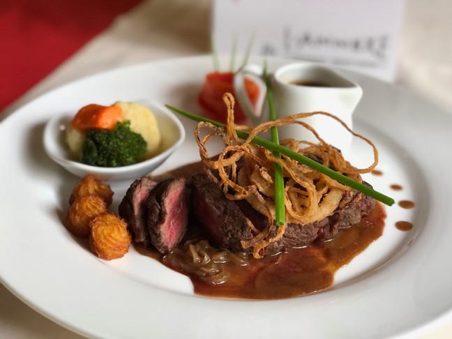 Steak of beef hanging by L'Annexe french restaurant in siem reap.jpg