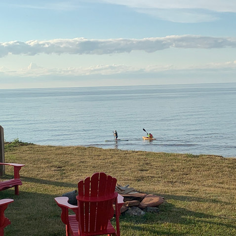 Paddle board in shallow water off the beach
