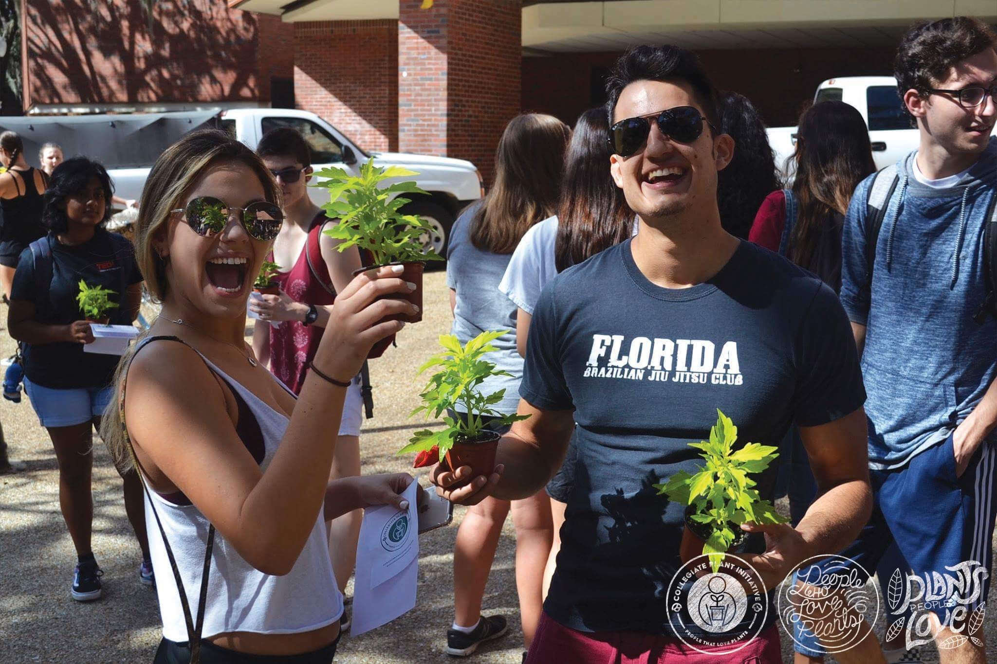 Two Students Posing Plant Drop
