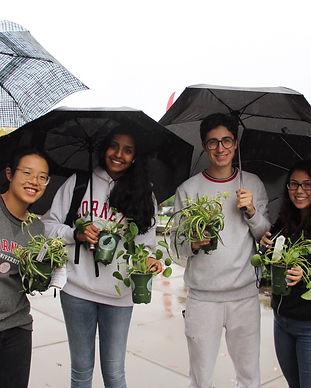 Corel students enjoying free plants from Peace Tree Farm at a CPI Plant Drop