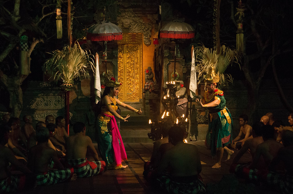 Female dancers help tell the story of Ramayana, a Hindu epic. The Kecak dance comes from a sacred dance form known as Sanghyang, where a person is possessed by a spirit to communicate with gods or ancestors and the dance is interpreted to convey their words.