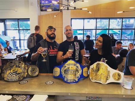 Champions of UCE Wrestling Celebrating