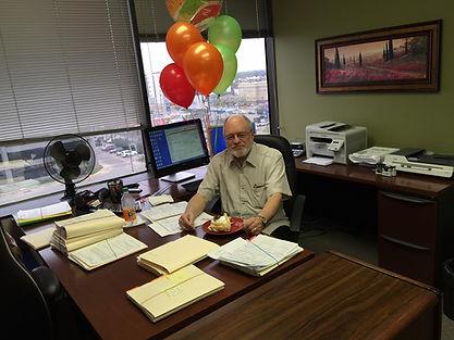 James 5th anniv at desk.JPG