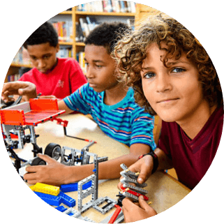 Elementary boys in stem class building robots funded by donations