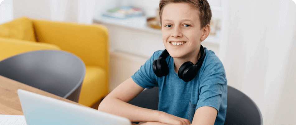Elementary boy on computer in a stem virtual tutoring class