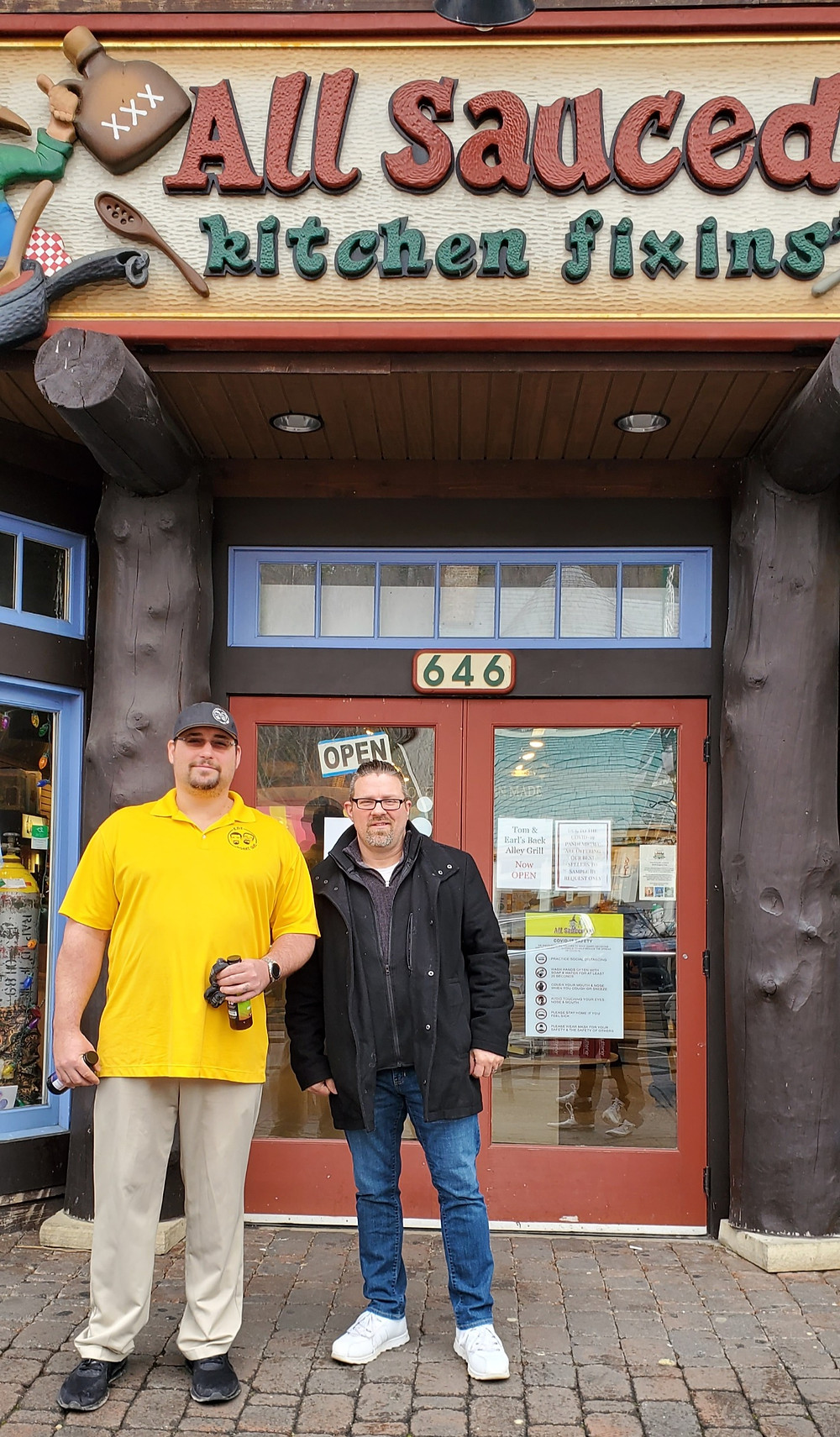 Picture of Eric and Denim in front of All Sauced Up store in Gatlinburg, TN.