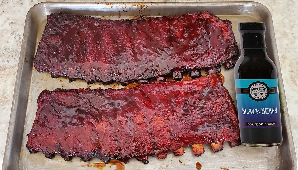 Picture of cooked spare ribs with blackberry bourbon glaze.