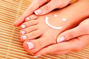 Pedicure with smiley lotion face iStock_