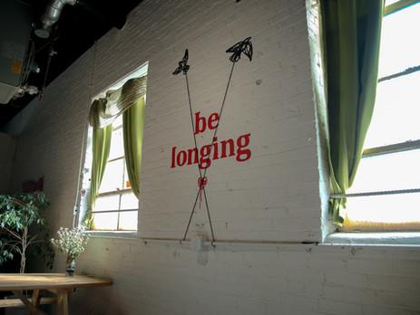 be longing, belonging