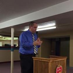 Pastor speaking to Staff