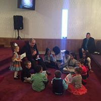Pastor with Sunday School Children