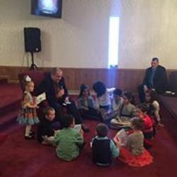 Pastor with Sunday School Children