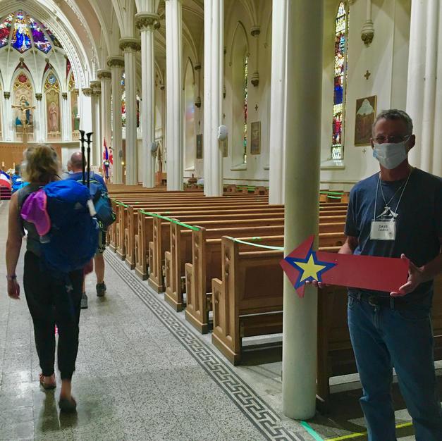Pilgrims arrive at cathedral.jpg