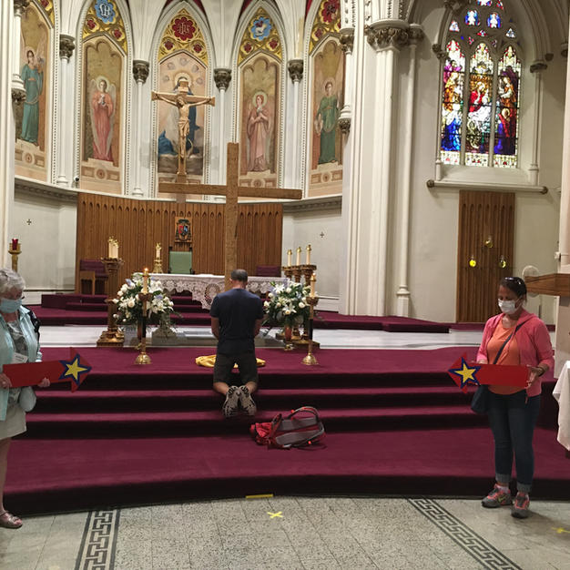 Pilgrim prayer at cathedral.JPG
