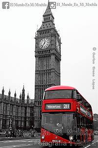 Fotografia de una autobus de londres con el big ben detras