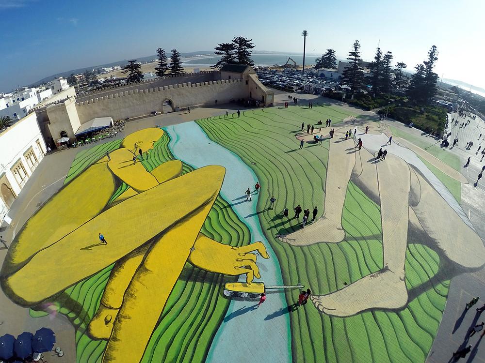 Giant mural on public square Essouaira by artist Giacomo Bufarini RUN