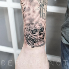 realistic small skull tattoo, dermapunct