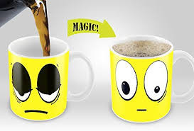 What is the technique behind magic mugs or photo changing mugs when hot water is poured in?