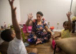 Tyra with kids raising hands.jpg
