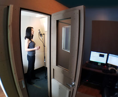 Katie, voice actor, performing in her vocal booth