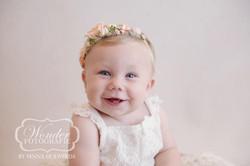 Sitter Session Babyportret Babyfotoshoot 8 maanden baby zelfstandig zitten mooi