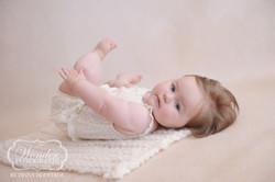 Sitter Sessie Babyfotoshoot 7 maanden baby zelfstandig zitten mooi