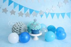 Cake Smash Fotoshoot blauwe doorlopende achtergrond sterren taart