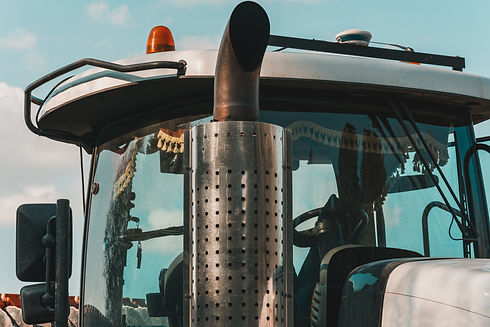 Catalytic converter tractor and cab with large windows close up on a background of blue sk