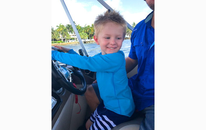 Capyain Liam at the helm