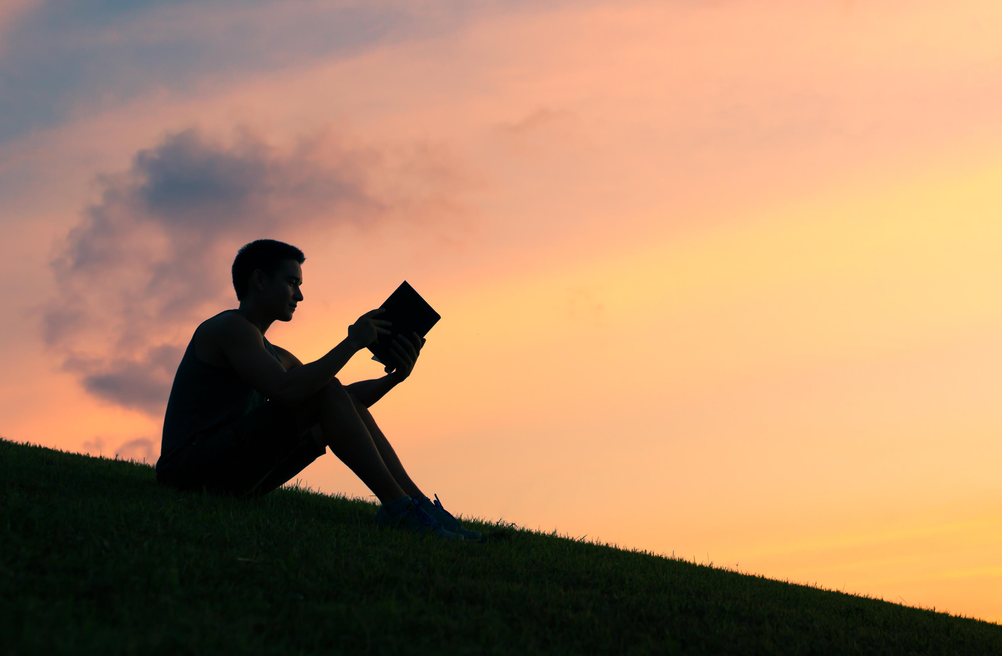 Man Studying at sunset