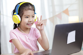 Asian little child girl learning at home