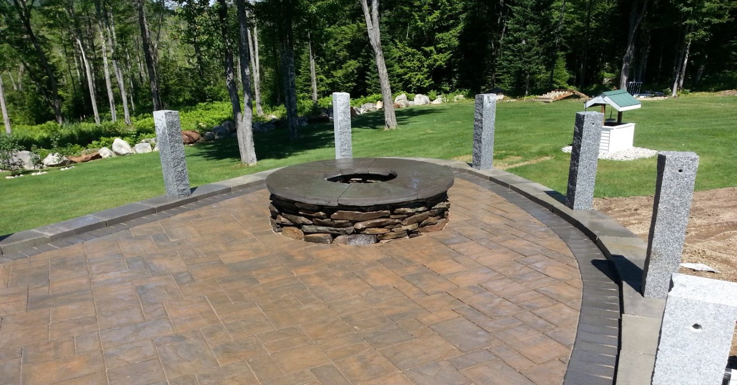 paver patio with hitching post rail and fire pit_edited