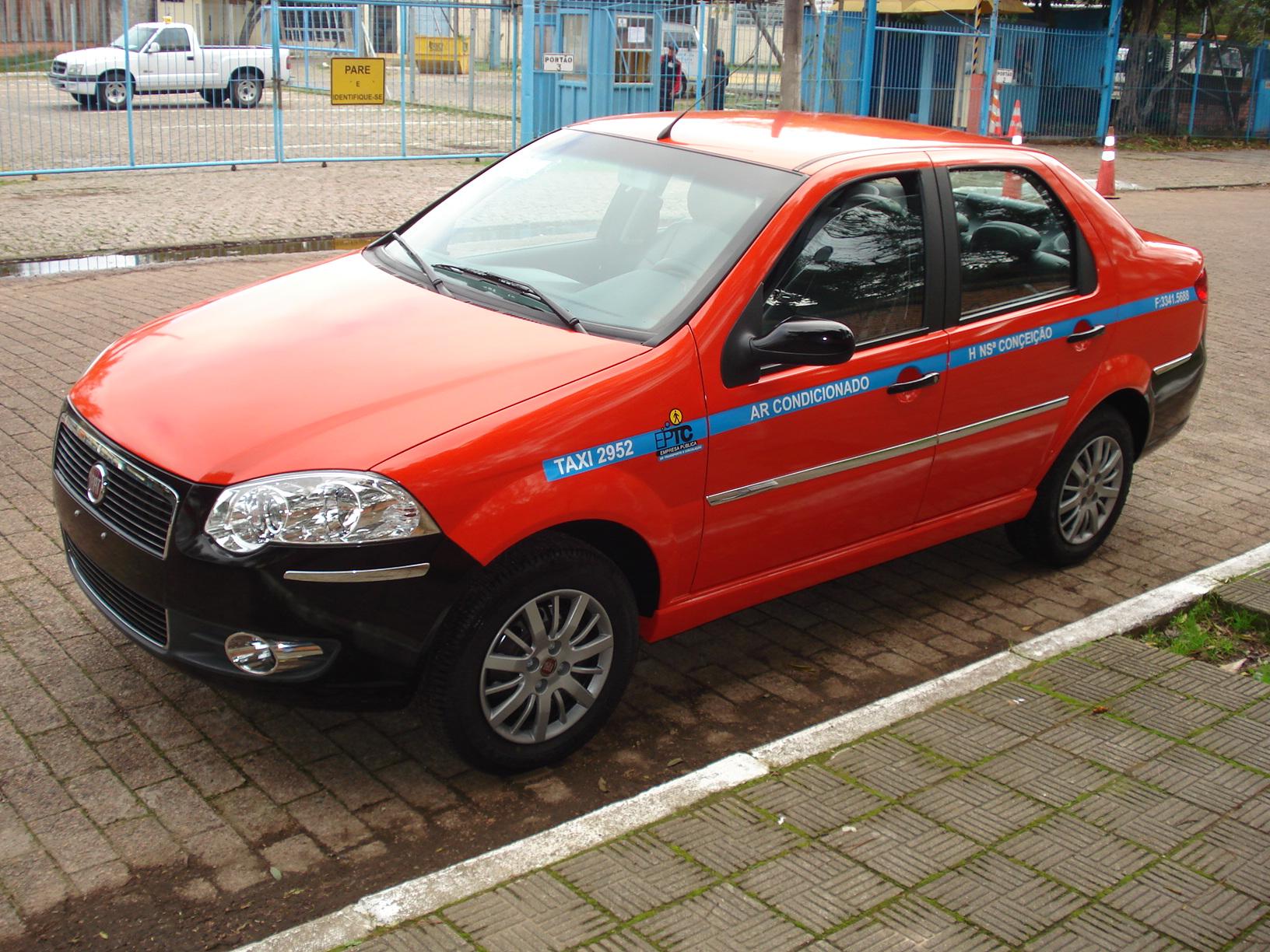 Primeiro Taxi Envelopado da Divulg