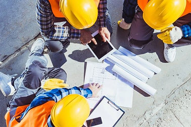 depositphotos_170349152-stock-photo-construction-workers-discussing-building-plans.jpg