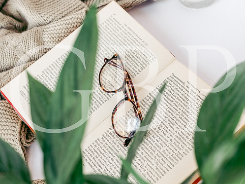 Stock Photo - Glasses on Book