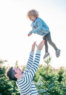 Father throwing daughter into the air Georgia-Beth Photography