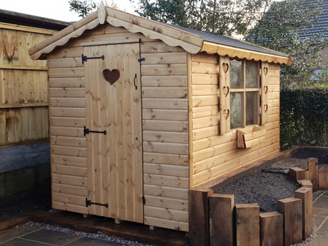 The traditional garden shed, even with a few extra trimmings such as this one, giving you a versatile building for storage, garden work, or even a private space to escape to.