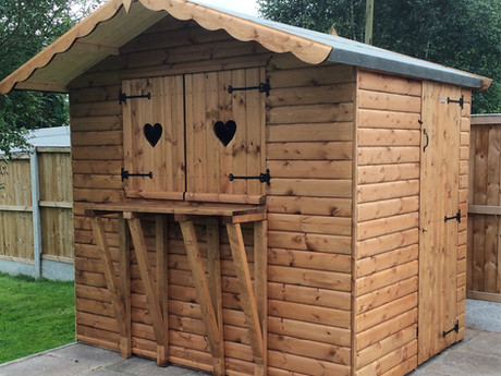 This log cabin features double opening shutters with heart-shaped cut outs and a serving counter. Whether you're serving food or drink at home or as part of your business, this garden bulding offers a practical use with a touch of style.