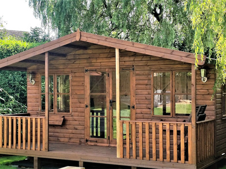 """The top of the range Buckingham summerhouse, available in a huge range of sizes and optional extras, such as this one with fully glazed doors and a 4'6"""" verandah. A garden summerhouse for the whole year around."""