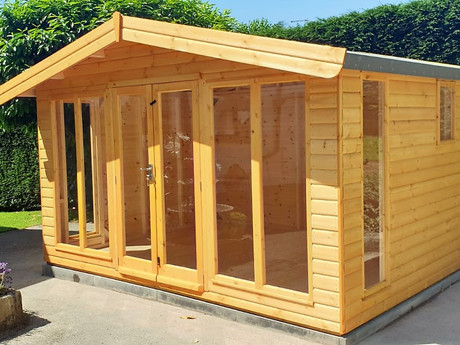 One of our grandest summer houses, the Norfolk range, with full-length glazed windows and doors, ideal for long summer days, or as a sung garden lounge for the cooler nights.
