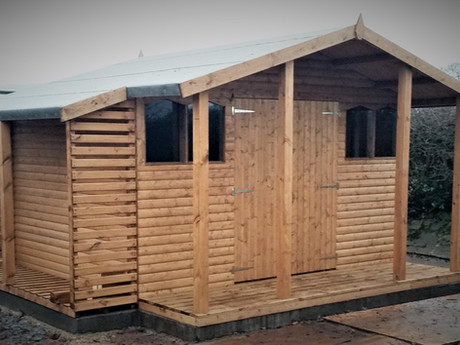 A heavy duty workshop heaturing double doors, a verandah and added log store. Whatever you do in your workshop, our heavy duty buildings will suit your needs.