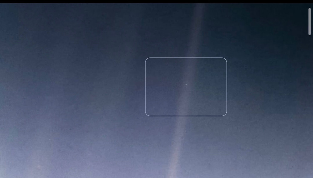 """A newly processed version of the iconic ""Pale Blue Dot"" image shows Earth 4 billion miles away from the NASA Voyager 1 spacecraft taken February 14, 1990."" NASA"